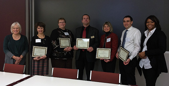 Pictured (L-R): Jeri-Lyn Garl, USEPA Region 5; Kathy Davey, USEPA HQ; Laura Barnes; Dan Marsch; Laura Babcock, MNTAP; Daniel Tietelbaum, USEPA HQ; Christine Anderson, USEPA Region 5